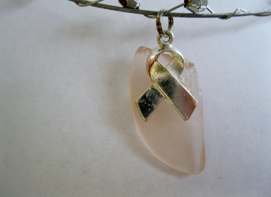 Breast-Cancer-Awareness-Charm-on-Pink-Beach -lass
