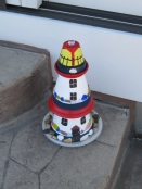 SMALL TERRACOTTA LIGHTHOUSE